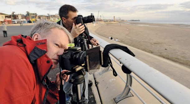 Apprentice feature landscape photographer Tom Mackie teaching reader Jim in Blackpool shooting seaside scenes on canon cameras